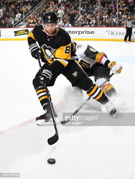 Brian Dumoulin of the Pittsburgh Penguins moves the puck in front of Colin Miller of the Vegas Golden Knights at PPG Paints Arena on February 6 2018...
