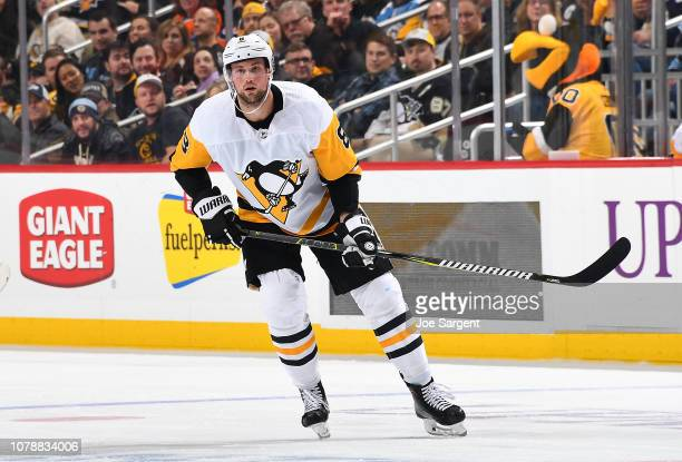Brian Dumoulin of the Pittsburgh Penguins skates against the Philadelphia Flyers at PPG Paints Arena on December 1 2018 in Pittsburgh Pennsylvania
