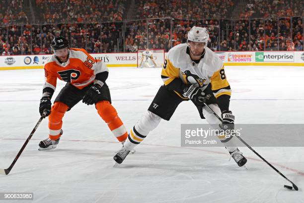 Brian Dumoulin of the Pittsburgh Penguins skates past Jakub Voracek of the Philadelphia Flyers during the first period at Wells Fargo Center on...