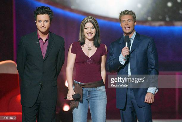 Brian Dunkleman Kelly Clarkson and Ryan Seacrest at FOXTV's American Idol in Los Angeles Ca Wednesday August 28 2002 Photo by Kevin...
