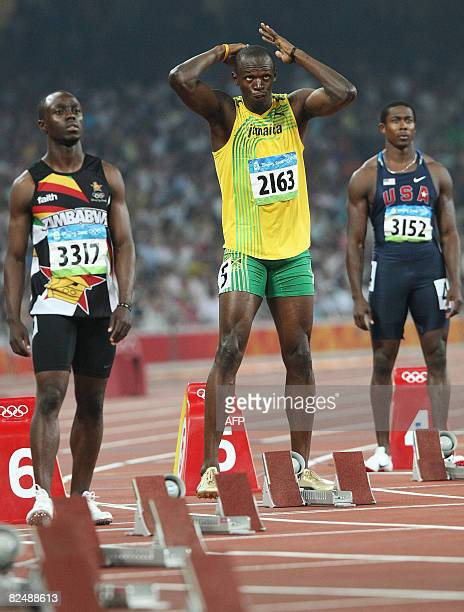 Brian Dzingai of Zimbabwe Jamaica's Usain Bolt and Shawn Crawford prepare for the men's 200m final at the National Stadium as part of the 2008...
