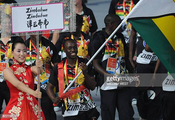Brian Dzingai Zimbabwe's flag bearer parades in front of his delegation during the 2008 Beijing Olympic Games opening ceremony on August 8 2008 at...