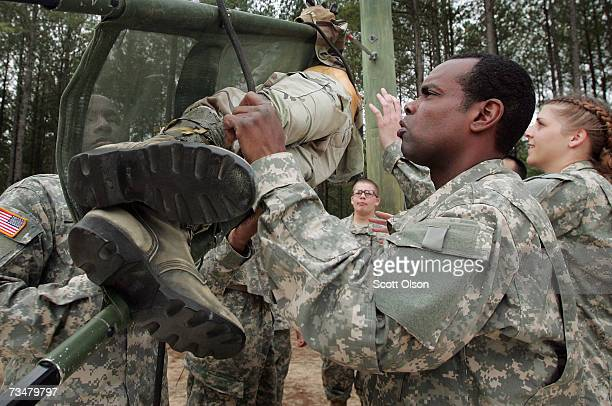 Brian Elisha of Burlington New Jersey helps fellow soldiers at a teamwork drill during Army basic training at Fort Jackson March 1 2007 in Columbia...