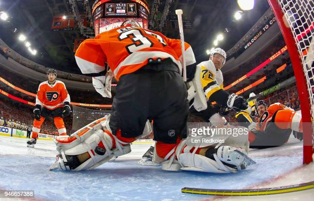 Brian Elliott and Andrew MacDonald of the Philadelphia Flyers surrender a second period powerplay goal to Derick Brassard of the Pittsburgh Penguins...