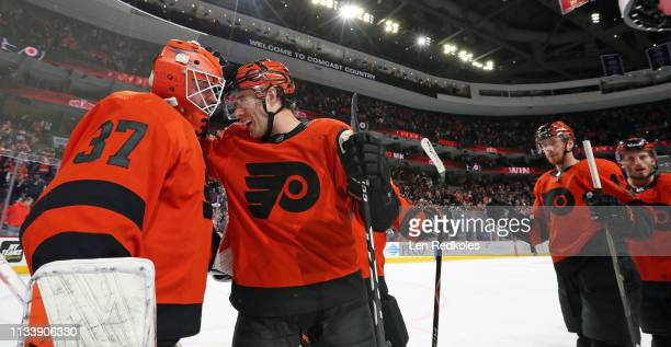Brian Elliott and Corban Knight of the Philadelphia Flyers celebrate with teammates after defeating the Buffalo Sabres 52 on February 26 2019 at the...