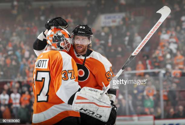 Brian Elliott and Jakub Voracek of the Philadelphia Flyers celebrate the win over the St Louis Blues on January 6 2018 at Wells Fargo Center in...