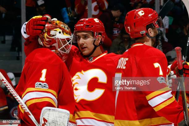 Brian Elliott and teammates of the Calgary Flames celebrate a win against the Montreal Canadiens after an NHL game on March 9 2017 at the Scotiabank...