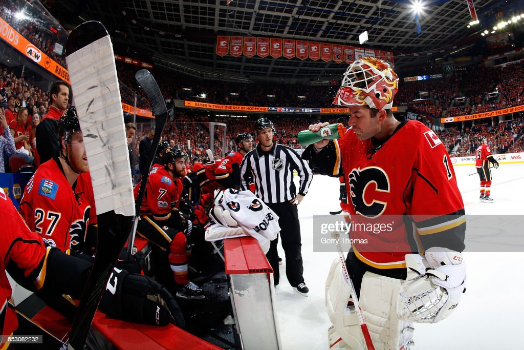 Brian Elliott #1 of the Calgary Flames gets a drink during an NHL game against the Pittsburgh Penguins on March 13, 2017 at the Scotiabank Saddledome in Calgary, Alberta, Canada.