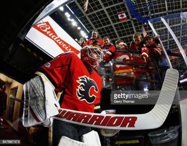 Brian Elliott of the Calgary Flames leads his team out on to the ice for warm up prior to puck drop against the Detroit Red Wings at Scotiabank...
