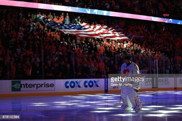 Brian Elliott of the Calgary Flames looks on during the national anthem prior to Game Two of the Western Conference First Round during the 2017 NHL...