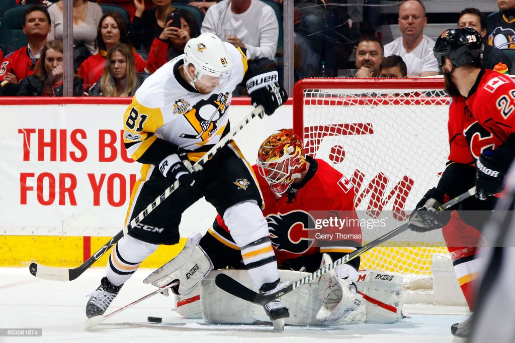 Brian Elliott #1 of the Calgary Flames makes a save against Phil Kessel #81 of the Pittsburgh Penguins during an NHL game on March 13, 2017 at the Scotiabank Saddledome in Calgary, Alberta, Canada.