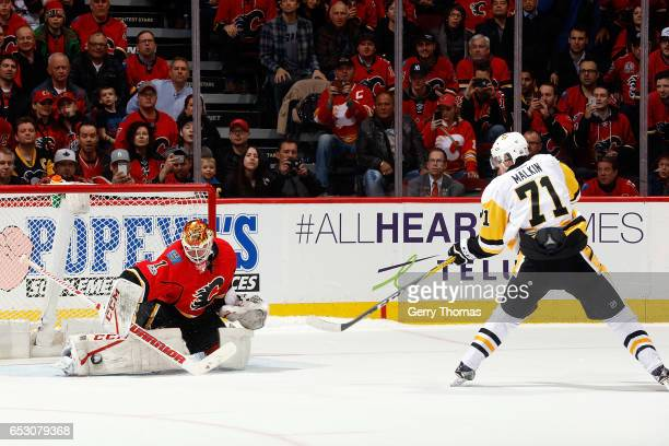 Brian Elliott of the Calgary Flames makes a shootout save against Evgeni Malkin of the Pittsburgh Penguins during an NHL game on March 13, 2017 at...
