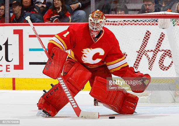 Brian Elliott of the Calgary Flames plays the puck against the New York Rangers at Scotiabank Saddledome on November 12 2016 in Calgary Alberta Canada