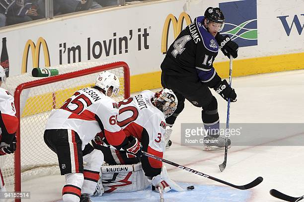Brian Elliott of the Ottawa Senators defends in the crease from a shot from Justin Williams of the Los Angeles Kings during the game on December 3,...