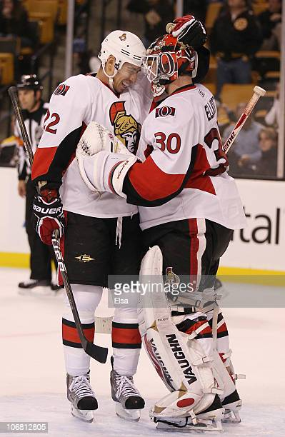 Brian Elliott of the Ottawa Senators is congratulated by Chris Kelly after Elliot shut out the Boston Bruins on November 13 2010 at the TD Garden in...