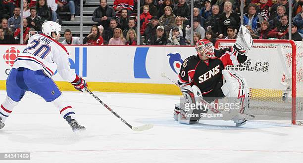 Brian Elliott of the Ottawa Senators makes a glove save on a shorthanded breakaway shot by Robert Lang of the Montreal Canadiens at Scotiabank Place...