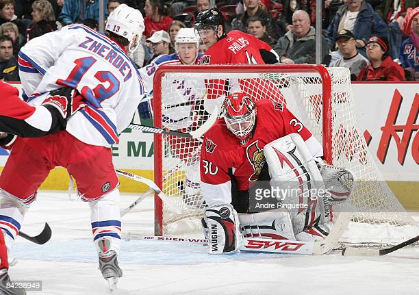 Brian Elliott of the Ottawa Senators makes a save against a shot in tight by Nikolai Zherdev of the New York Rangers at Scotiabank Place on January...