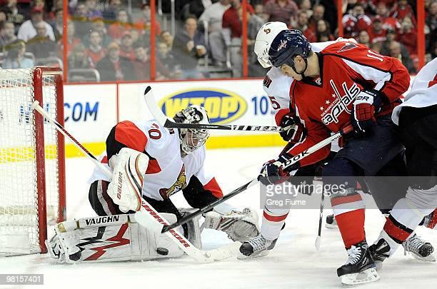 Brian Elliott of the Ottawa Senators makes a save against Matt Bradley of the Washington Capitals at the Verizon Center on March 30, 2010 in...