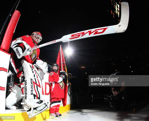 Brian Elliott of the Ottawa Senators steps on the ice during player introductions for his start against the New York Rangers after being called up...