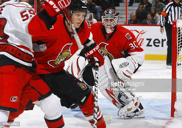Brian Elliott of the Ottawa Senators tries to follow the play in the corner during a game against the Carolina Hurricanes at Scotiabank Place on...