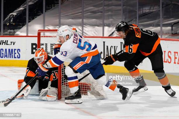Brian Elliott of the Philadelphia Flyers blocks Casey Cizikas of the New York Islanders during the second period at Wells Fargo Center on January 31,...