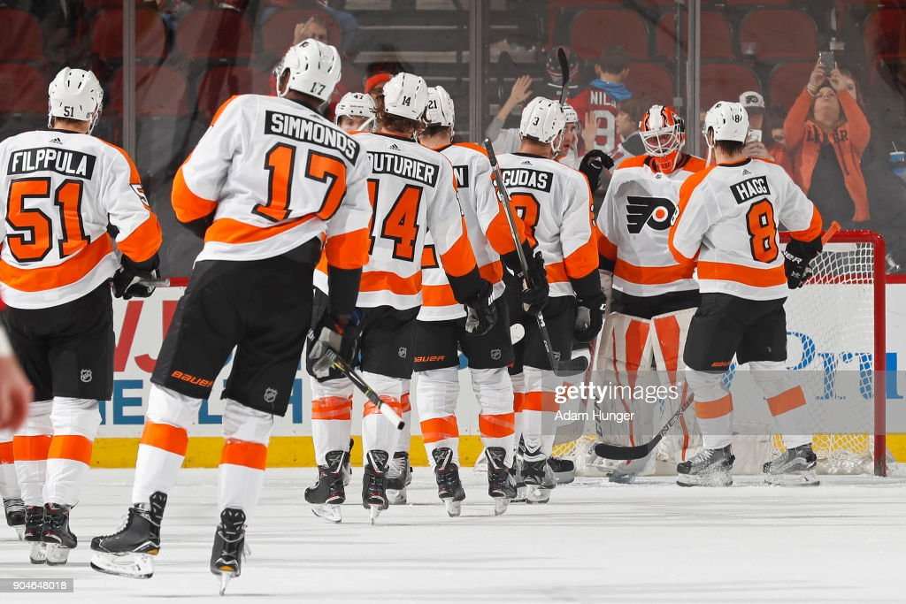 Brian Elliott #37 of the Philadelphia Flyers celebrates with teammates after defeating the New Jersey Devils at the Prudential Center on January 13, 2018 in Newark, New Jersey. The Flyers won 5-3.