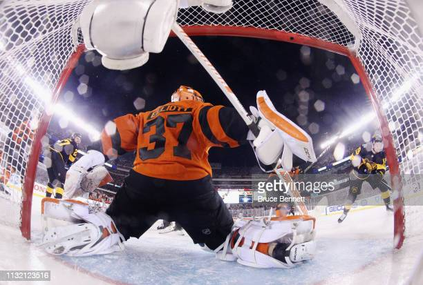 Brian Elliott of the Philadelphia Flyers defends the net against the Pittsburgh Penguins during the 2019 Coors Light NHL Stadium Series game at the...
