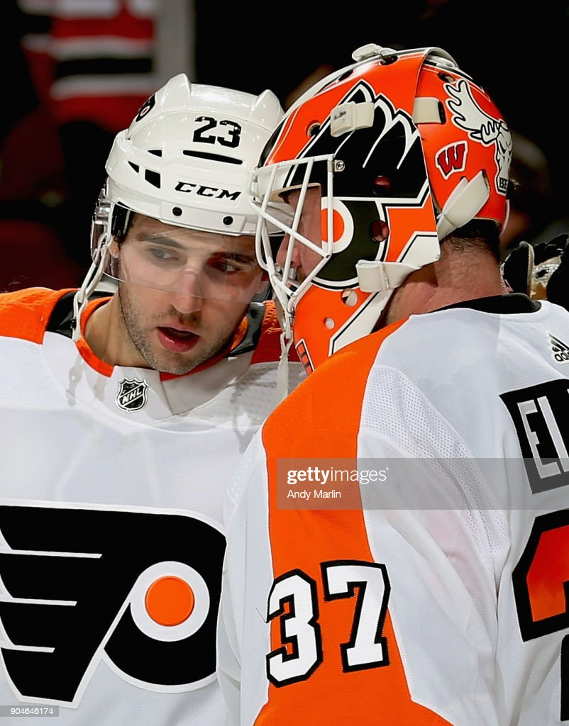 Brian Elliott #37 of the Philadelphia Flyers is congratulated by Brandon Manning #23 after defeating the New Jersey Devils at Prudential Center on January 13, 2018 in Newark, New Jersey.