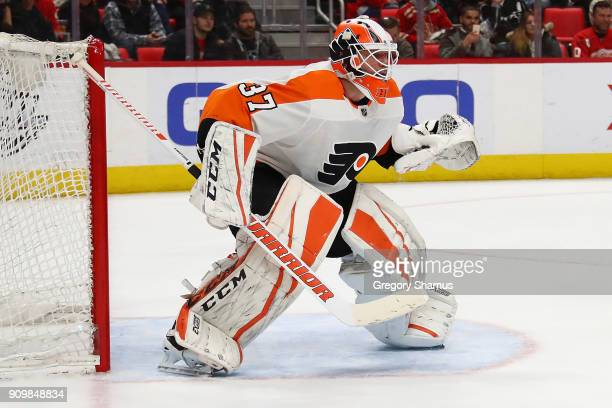 Brian Elliott of the Philadelphia Flyers looks on while playing the Detroit Red Wings at Little Caesars Arena on January 23 2018 in Detroit Michigan