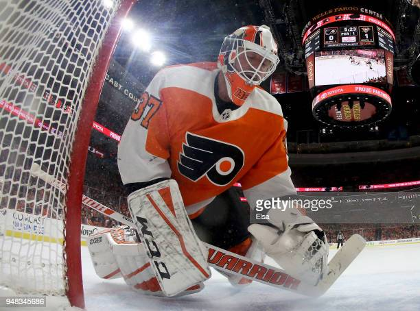 Brian Elliott of the Philadelphia Flyers reacts after Phil Kessel of the Pittsburgh Penguins scored in the first period in Game Four of the Eastern...