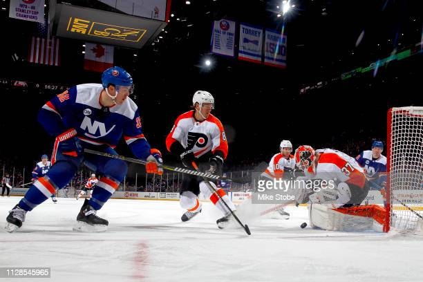 Brian Elliott of the Philadelphia Flyers stops a shot from Ross Johnston of the New York Islanders during the second period at NYCB Live's Nassau...