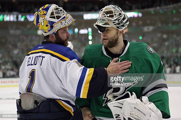 Brian Elliott of the St Louis Blues and Antti Niemi of the Dallas Stars talk after the Blues won 61 in Game Seven of the Western Conference Second...
