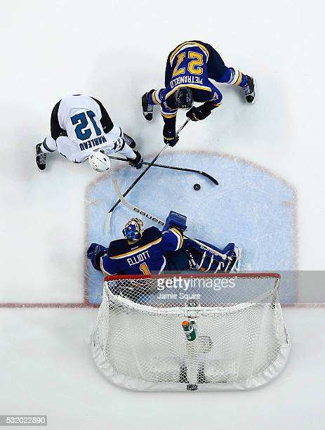 Brian Elliott of the St Louis Blues tends goal against Patrick Marleau of the San Jose Sharks as Alex Pietrangelo of the St Louis Blues defends...