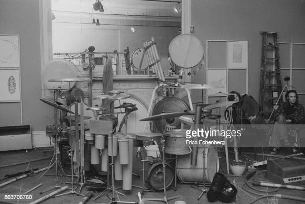 Brian Eno in a recording studio with various drums and drum kits Earls Court London 1975