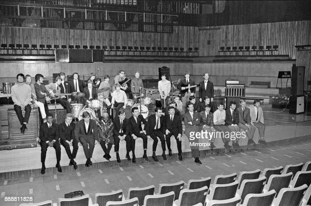 Brian Epstein pictured with some of the groups appearing at 'An Evening of Popular British Music° at The Commonwealth Arts Festival held at The Royal...