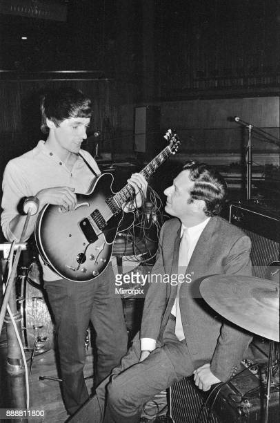 Brian Epstein talks to a guitarist from one of the British bands appearing at 'An Evening of Popular British Music° at The Commonwealth Arts Festival...