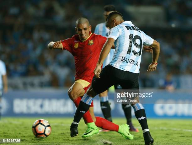 Brian Ezequiel Mansilla of Racing Club kicks the ball to score the first goal of his team during a first leg match between Racing and Rionegro...