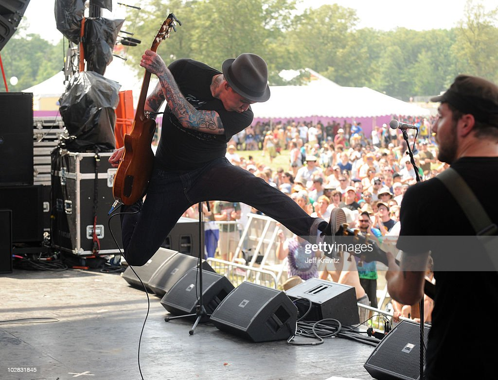 Brian Fallon and Alex Rosamilia of The Gaslight Anthem perform onstage during Bonnaroo 2010 at Which Stage on June 11, 2010 in Manchester, Tennessee.