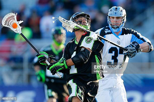 Brian Farrell of the Ohio Machine defends against JoJo Marasco of the New York Lizards at James M Shuart Stadium on April 12 2015 in Hempstead New...