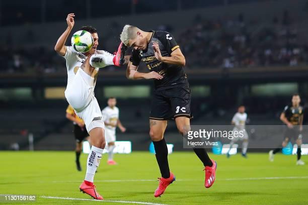 Brian Figueroa of Pumas struggles for the ball with Gustavo Canto of Dorados de Sinaloa during the quarterfinals match between Pumas UNAM and Dorados...