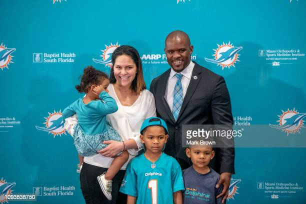Brian Flores poses with his family as he is introduced as the new Head Coach of the Miami Dolphins at Baptist Health Training Facility at Nova...