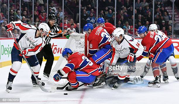 Brian Flynn Nikita Scherbak and Nathan Beaulieu of the Montreal Canadiens defend the goal against Marcus Johansson and Justin Williams of the...