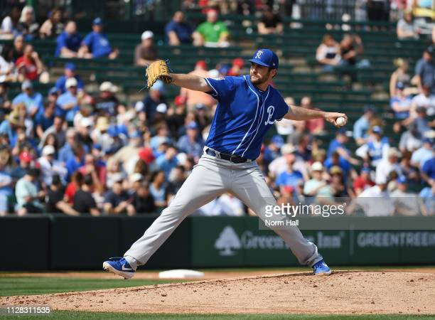 Brian Flynn of the Kansas City Royals delivers a first inning pitch during a spring training game against the Los Angeles Angels of Anaheim at Tempe...