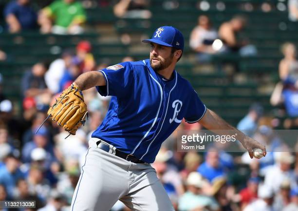 Brian Flynn of the Kansas City Royals delivers a pitch during a spring training game against the Los Angeles Angels of Anaheim at Tempe Diablo...