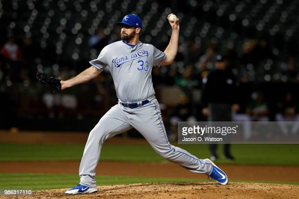 Brian Flynn of the Kansas City Royals pitches against the Oakland Athletics during the seventh inning at the Oakland Coliseum on June 8 2018 in...