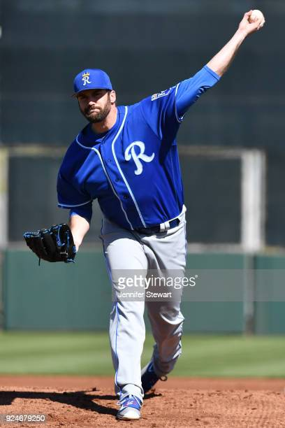 Brian Flynn of the Kansas City Royals throws a warm up pitch prior to the first inning of the spring training game against the San Francisco Giants...