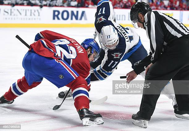 Brian Flynn of the Montreal Canadiens and Adam Lowry of the Winnipeg Jets face off in the NHL game at the Bell Centre on November 1 2015 in Montreal...