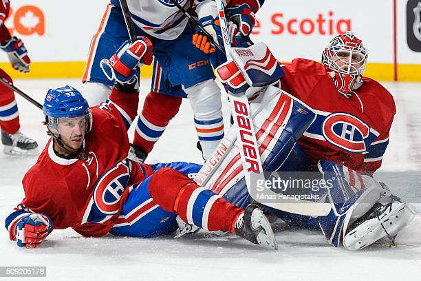 Brian Flynn of the Montreal Canadiens helps defend the net of goaltender Ben Scrivens during the NHL game against the Edmonton Oilers at the Bell...