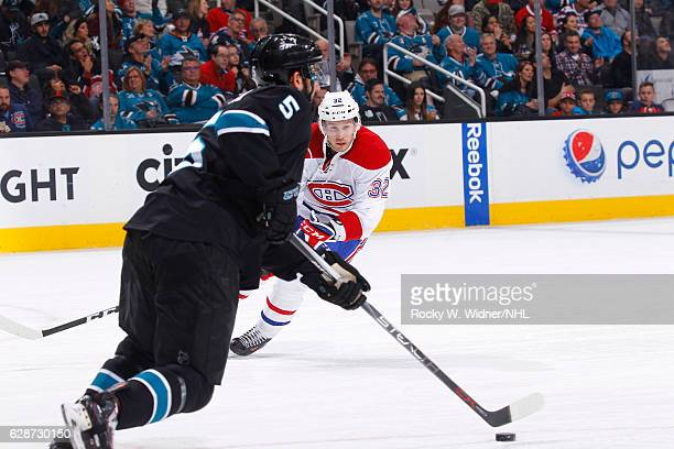 Brian Flynn of the Montreal Canadiens skates after the puck against David Schlemko of the San Jose Sharks at SAP Center on December 2, 2016 in San...