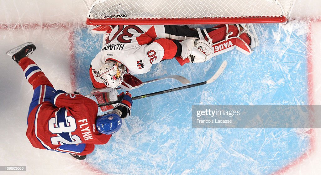 Brian Flynn #32 of the Montreal Canadiens takes a shot on goal Andrew Hammond #30 of Ottawa Senators in Game One of the Eastern Conference Quarterfinals during the 2015 NHL Stanley Cup Playoffs at the Bell Centre on April 15, 2015 in Montreal, Quebec, Canada.